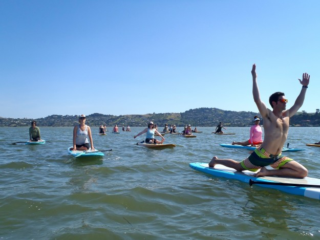 On the water yoga class.  Photo courtesy of OnBoard SUP Yoga.