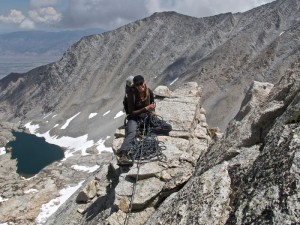 The author belaying on Mt. Carl Heller. Photo: Adam Long
