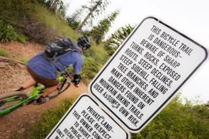 Rider drops into Sunrise Trail.