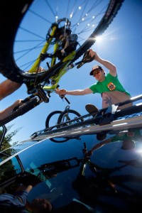 Andy Coughlin of Yuba Expeditions unloading bikes from the top of the shuttle van.