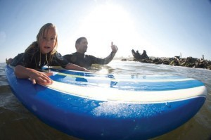 Surfing with your kids is a good reason to love Santa Cruz. Photo: Nelly/SPL