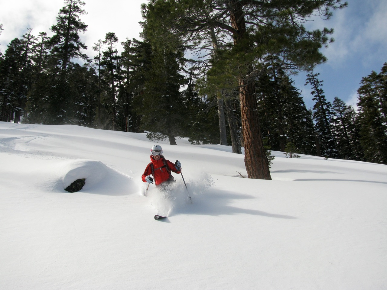 ) Rebecca Anderson smiles because it's perfect powder on Rubicon Peak, Lake Tahoe, CA.  Photo courtesy of Alpenlow Sports