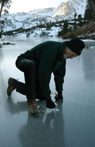 Brent Taylor checks the ice depth with an ice screw. Photo: Jeff Griffiths