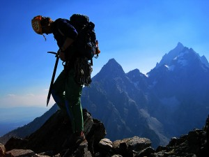 2012-09-07 - Steph on the summit of Symmetry Spire, sporting her mother's pants, pack and ice ax used on the 1982 climb.