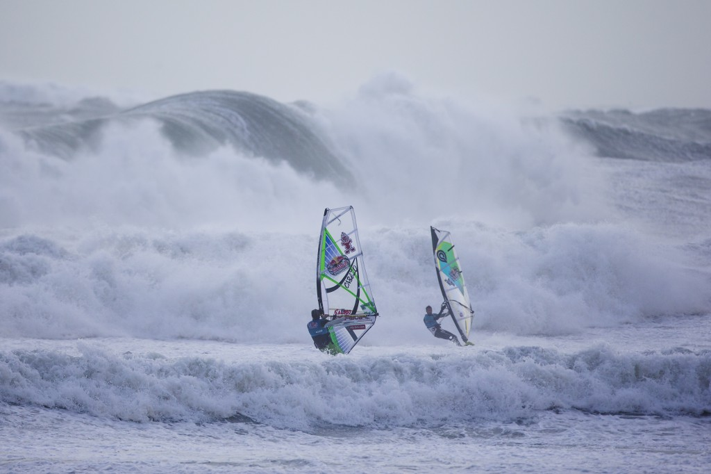 Dany Bruch of Germany and Marcillio Browne of Brasil sail past each other at the Mission 3 of the Red Bull Storm Chase at Gwithian bay in Cornwall, England on February 8 2014. Photo courtesy of Red Bull Storm Chase 2013/2014