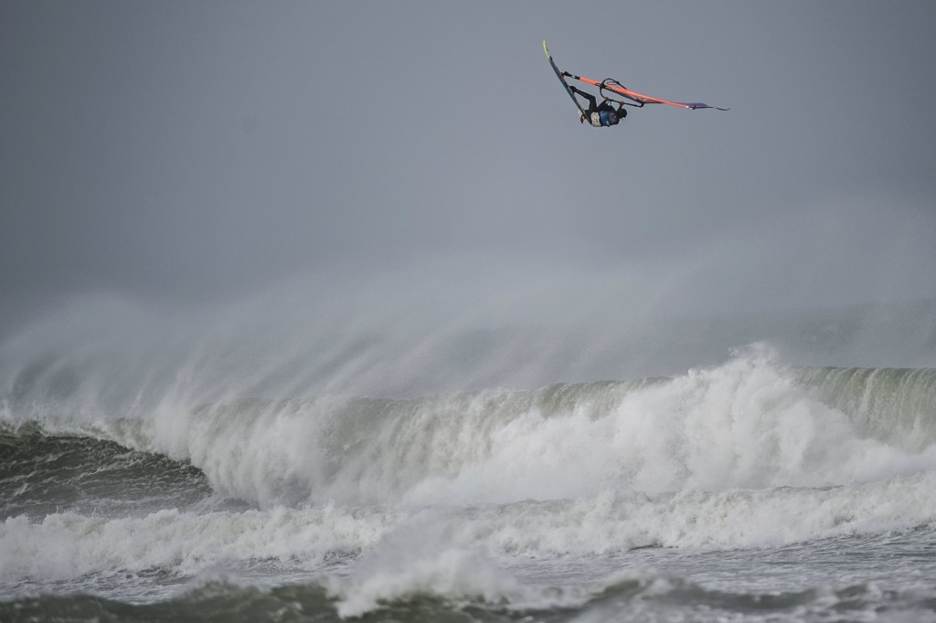 Thomas Traversa of France performs at the Mission 3 of the Red Bull Storm Chase at the Bluff in Cornwall, England on February 8 2014. Photo: Sebastian Marko/Red Bull Content Pool