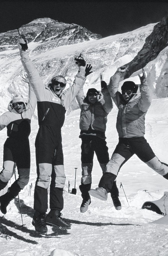 Kevin Doyle, Jim Elzinga, Albi Sole, and Barry jump for joy and relief on hearing that Sharon and Dwayne are OK after making the summit of Mount Everest. Photo: Bob Lee