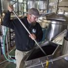 Chad Brill checks the hops and patrons enjoy a unique, copper clad taproom (Santa Cruz Moutnain Brewing).