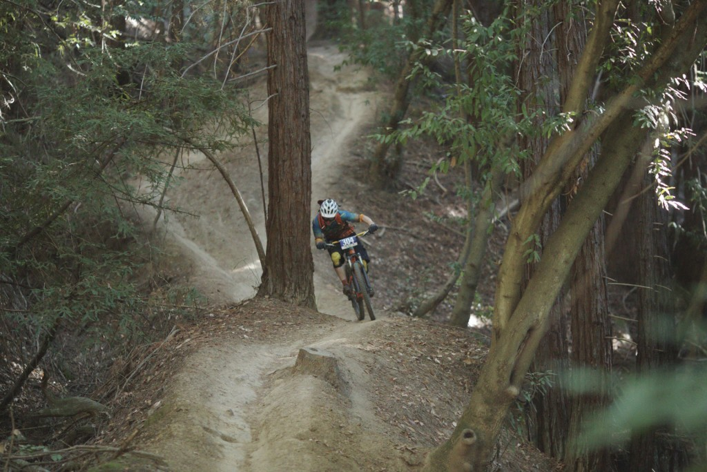 Junior racer Liam Ruff hugs tight against the trees—the straightest, fastest way down stage 2.