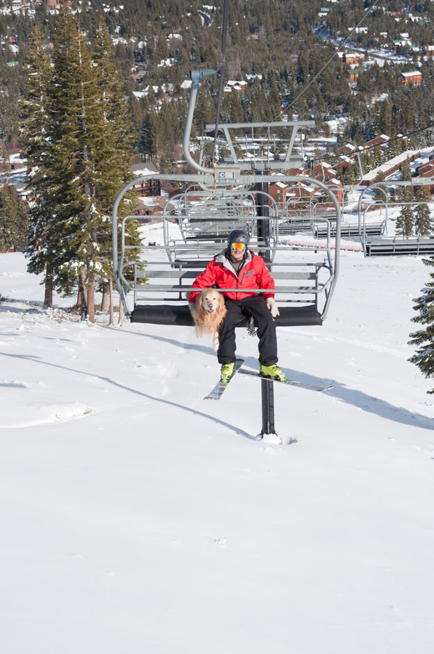 Tucker catches a lift up the mountain with Ski Patrol Director Ted Tank.
