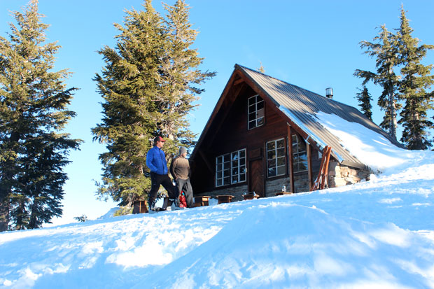 The crew scopes morning conditions outside of the comforts of the Benson Hut (Dave Zook).