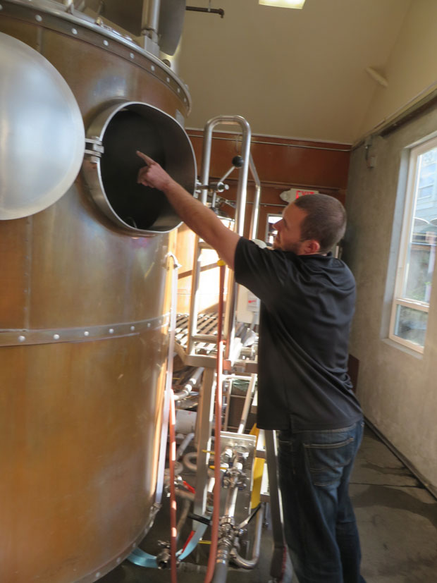 General Manager Nate Rey explaining the Mash Tun process, where they steep the malted barley in hot water.