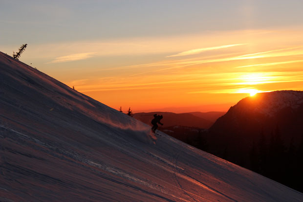 Dylan Fournier gets a sunset slash a few hundred feet from the front door of the hut as the sun sets (Dave Zook).