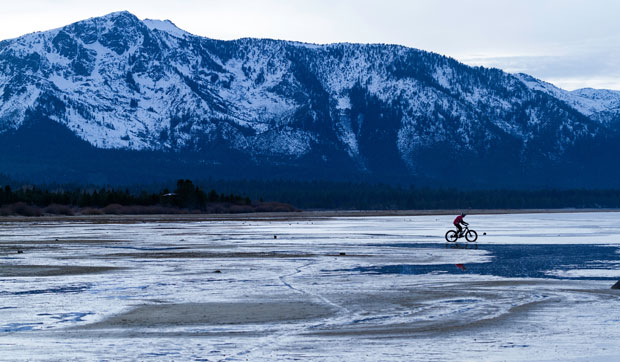 Anthony Cupaiuolo riding ice along Lake Tahoe's shore (Merick Rickman).