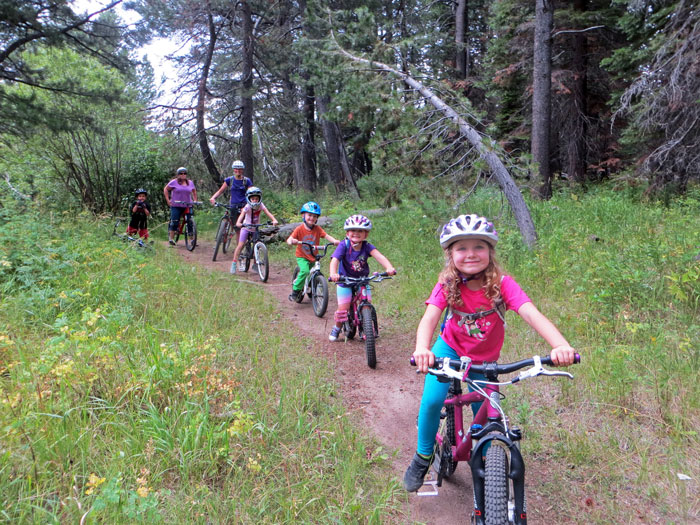 Kids enjoying some easy single track during the Meyers Mountain Bike Festival. Photo by Ben Fish