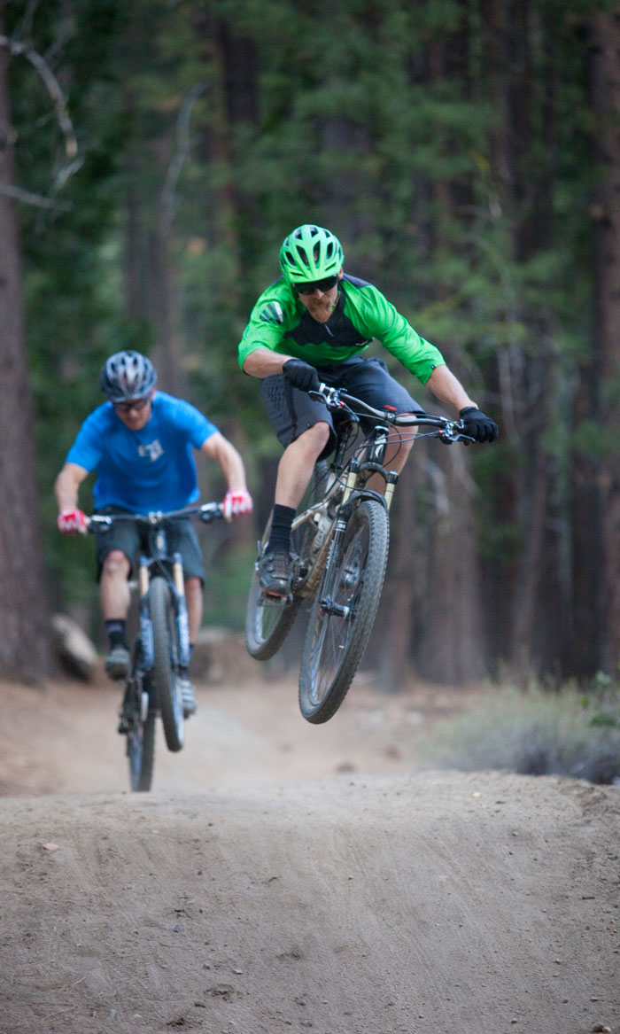 Riders testing out the new jumps that TAMBA built last year on the Corral Trail.  Photo by  Rick Gunn