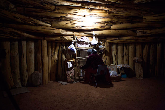 A Navajo woman utlizes her new simple, clean GoalZero solar light system to operate her loom long after the sun has gone down. Photo: GoalZero