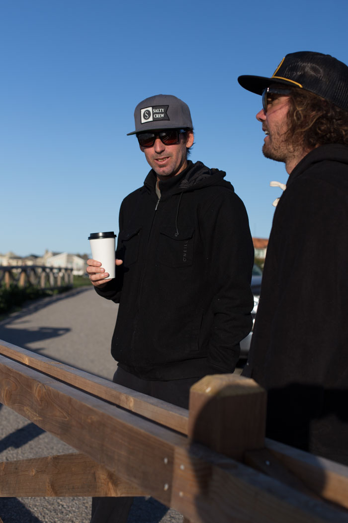 Checking the waves over a cup of joe.  Photo by Nelly