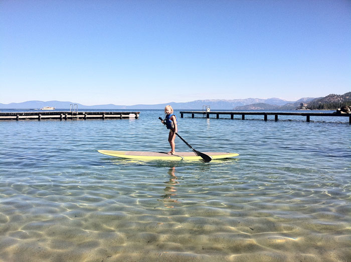 Young SUP'er on her way to circumnavigating Lake Tahoe, or a pint-sized portion there of.  Photo by Cathy Claesson