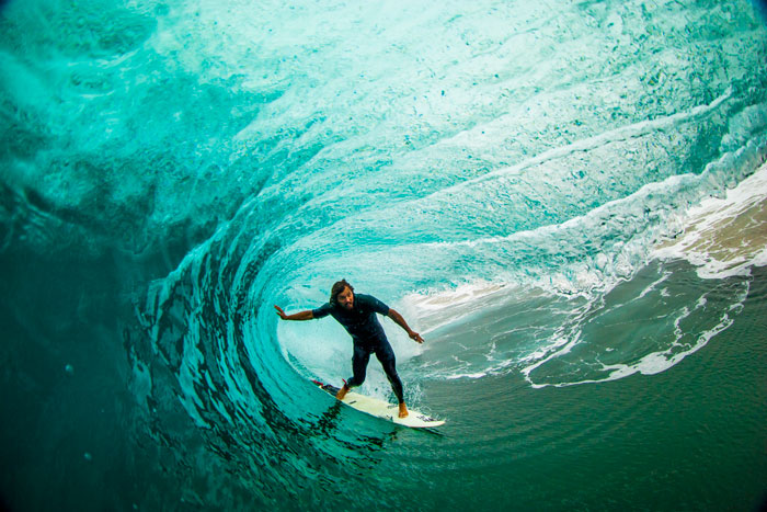 Timmy showing why he's one of the best tube riders in the world.  Photo by Nelly