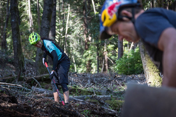 Specialized Enduro teammates Anneke Beerten and Curtis Keene are masters of making hard work fun. There may have been some friendly dig competition out there, too. (Etienne Van Rensburg)