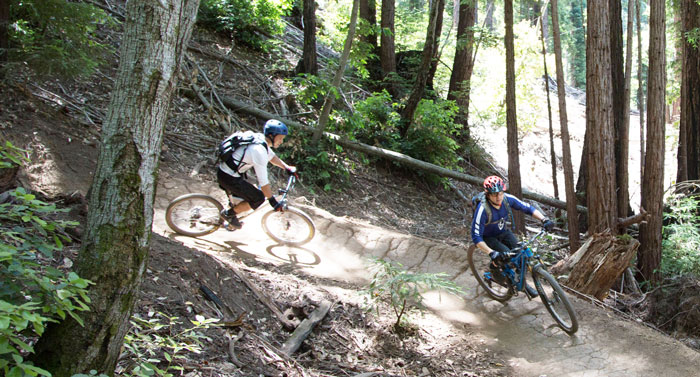 Riders enjoy one of the many berms on the 3.75 mile flow trail at Soquel Demonstration State Forest (SDSF). Photo: Bruce Dorman.