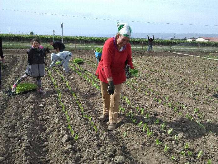 FarmLink client Delfina Corcoles on her farm in the Salinas Valley.