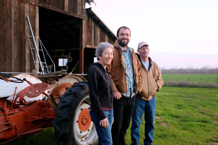 FarmLink clients Chris Hay (of Say Hay Farms) with landowners Pat Meade and Jon Robbins of Yolo County.