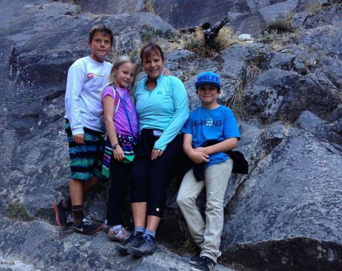 Cathy and her three kids on a hike last summer.