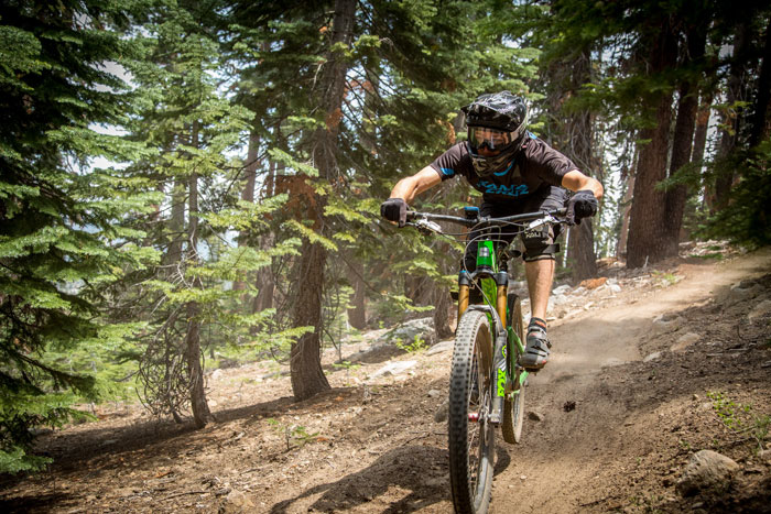 A Santa Cruz rider getting his flow down higher up on Stage 3.