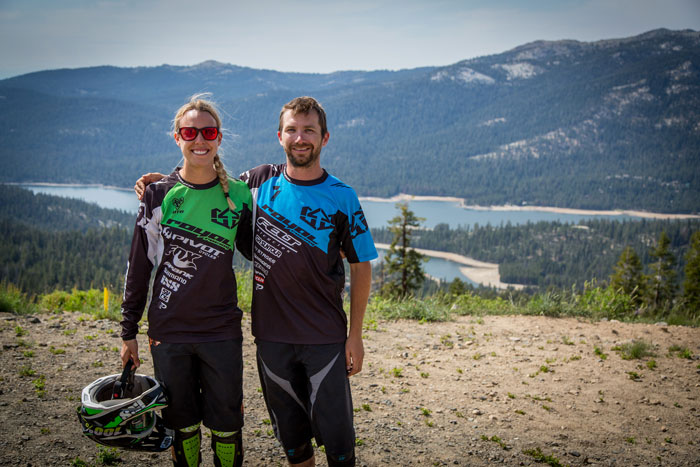Lauren Gregg and Casey Coffman posing for a photo with Huntington Lake in the background.