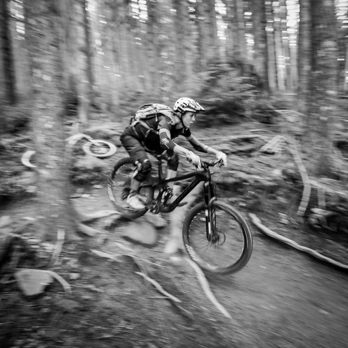 Kat Sweet rips techy singletrack on her Michelins.