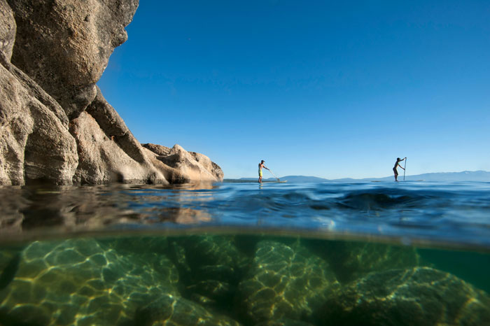 Stand up paddlers enjoy the Lake Tahoe Water Trail along the East Shore near Cave Rock. Photo: Corey Rich / Aurora Photos.