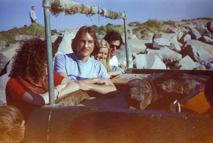 SOS founder Kim Tschantz and other volunteers survey a marine mammal.