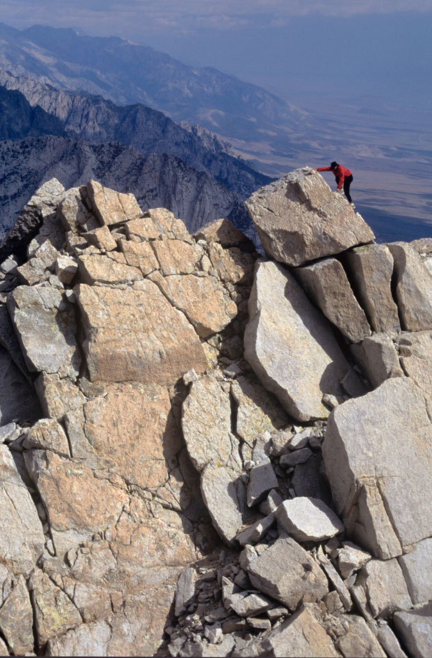 Brad Rassler on the crest of the North Ridge of Lone Pine Peak. Photo: Andy Selters.