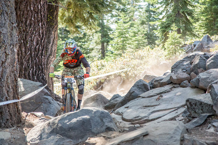 Cody Kelley of Marin Bikes Factory Team smashes the rock garden on Sticks and Stones.
