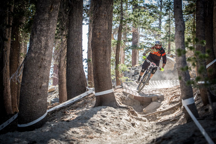 Carving a paver berm entering the woods on Stage 3.