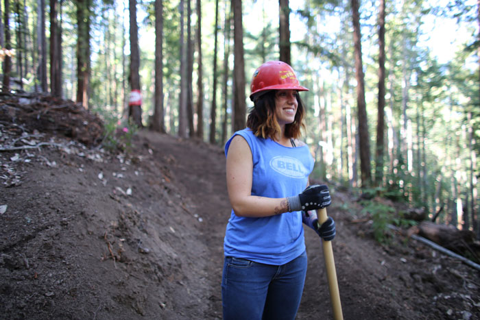 Pitching in to build and maintain trails demonstrates excellent in mountain biking. Photo: Bogdan Marian