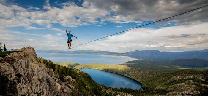 Peter Duin reaches for balance in beautiful Lake Tahoe. Photo: Larry Duin