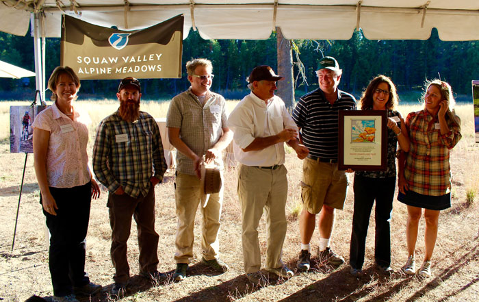 A proud and beaming Land Trust staff accepting a 25 Year Anniversary Proclamation. Photo: Susan Johnson