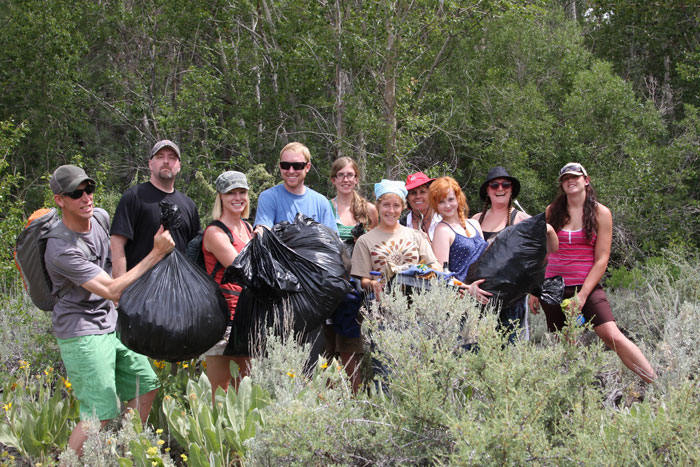 Volunteers remove invasive plants from creeks that feed the lake.