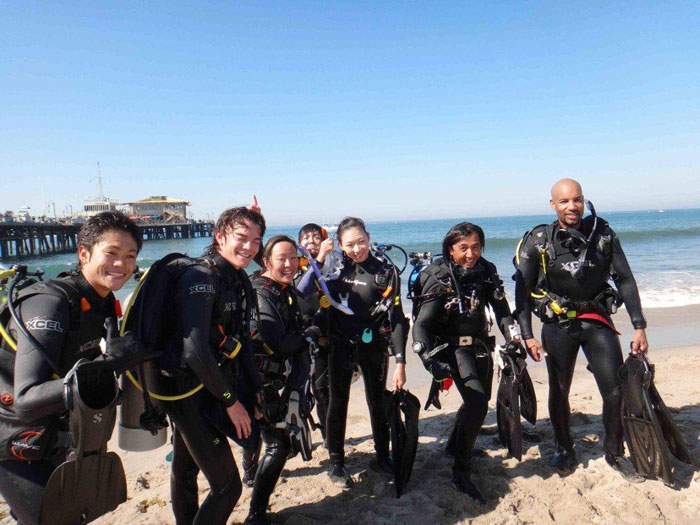 SCUBA divers remove trash from underneath the Santa Monica Pier on Coastal Cleanup Day.