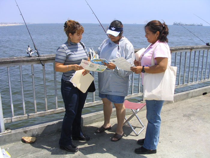 Angler Outreach Program volunteers educate fisherpeople.