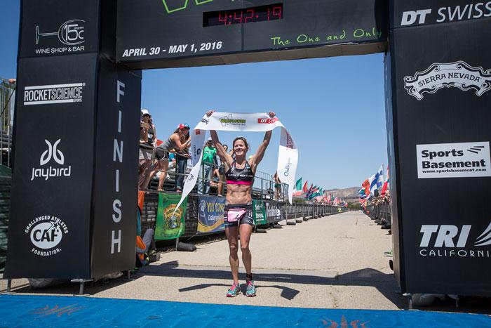 Liz Lyles crosses the line in first-place. Photo: Alex Felker