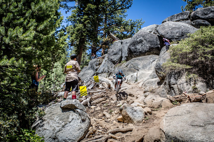 A rider bombs through the rock garden and the TRP Brake Zone.