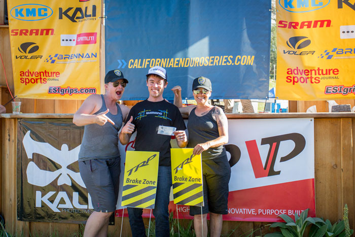 Jeff Kendall Weed with the TRP Brake Zone officers (CES co-founders Megan Gemelos and Michele Lamelin) after tying with Brian Lopes for the fastest speed through the stage 3 rock garden at 17.9 mph.