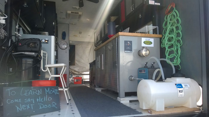 Plastic to Fuel machine inside the mobile research lab at Cabrillo College (Jim Holm).