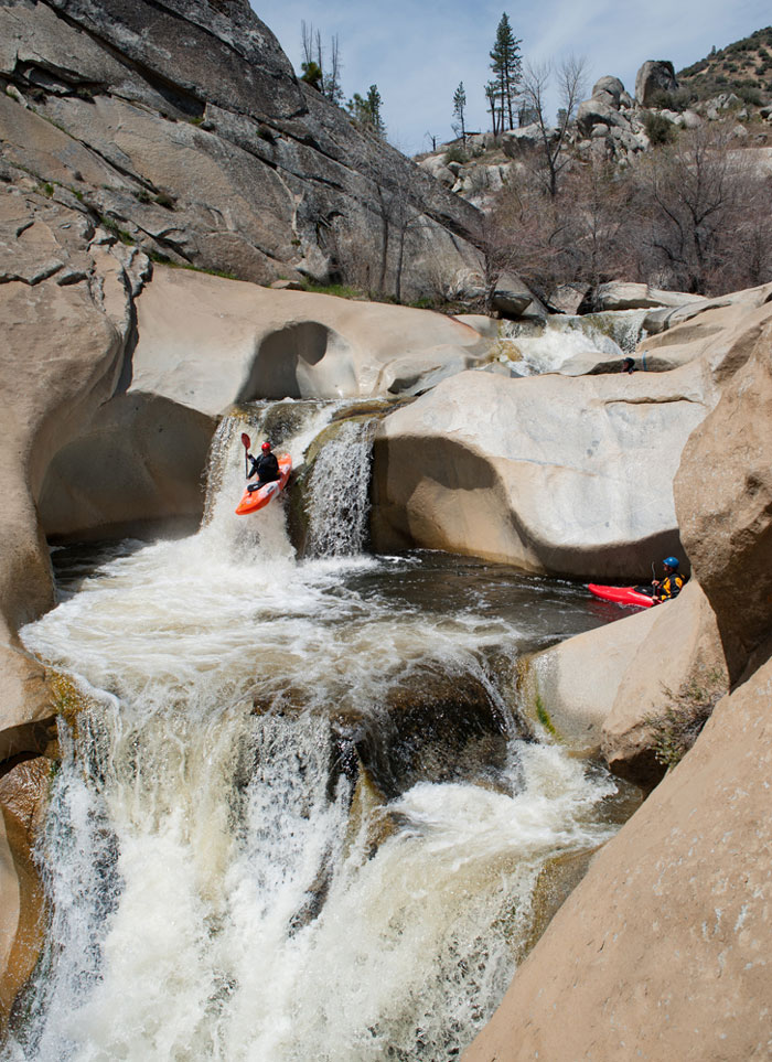 Daniel Brasuell catches air between tea cups on Dry Meadow Creek, tributary to the Kern River (Darin McQuoid).
