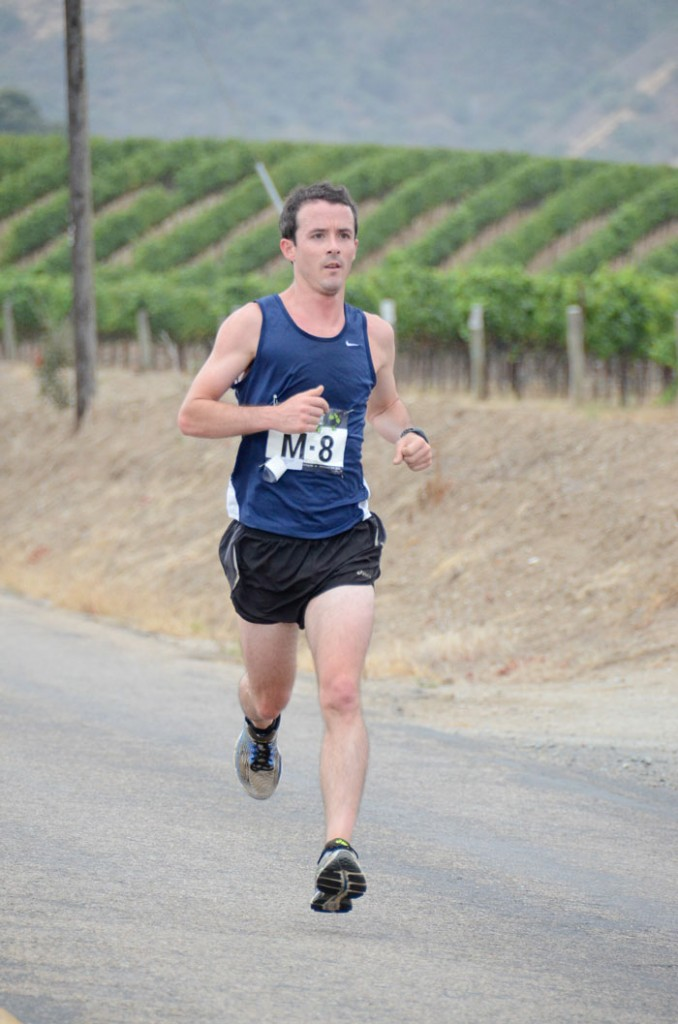 Monterey standout runner Eric Palmer runs past lush vineyards. Photo: Captivating Photos