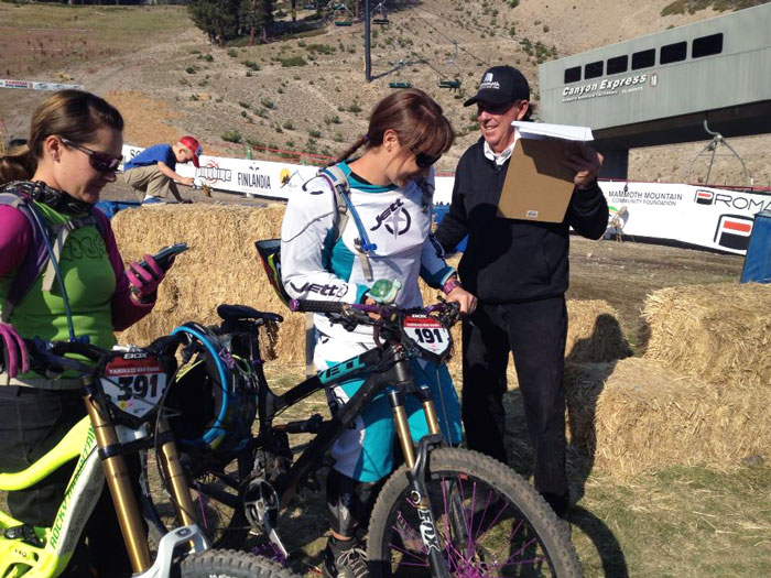 Racers check in with the man himself at the 2013 games. Thank you, Bill, for your commitment to and passion for mountain bike racing! (Michele Lamelin)
